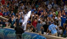 Anthony Rizzo Jumps on Tarp and Dives Into Stands to Make Amazing Catch on Foul Ball (Video)