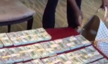 Money Mayweather Packs $1 Million into a Travel Bag (Video)