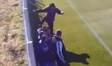Romanian Soccer Coach Repeatedly Kicks and Hits Player on Bench (Video)