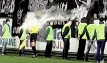 Serbian Soccer Fans Dump Bucket Of Water On Unsuspecting Linesman (Videos)