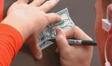 Johnny Manziel Signs Fan's $100 Bill As 'Money Manziel' (GIF)