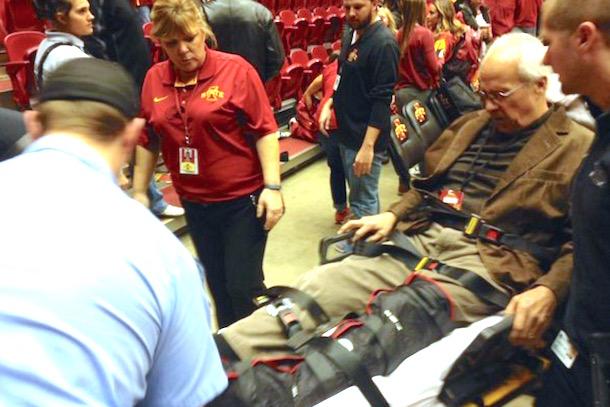 basketball reporter broken leg iowa state fans storm court