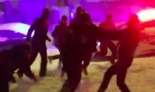 D.C. Cop Lays Down a Huge Stiff-Arm During Snowstorm Football Game (Video)