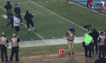 Cam Newton Takes A Nap On The Field As Cardinals Look On (PIC)