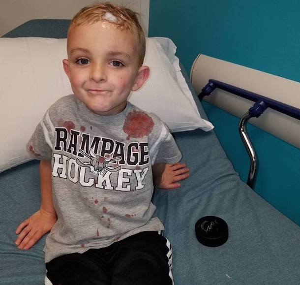 5-year-old hockey fan james evans puck to head er staples 3
