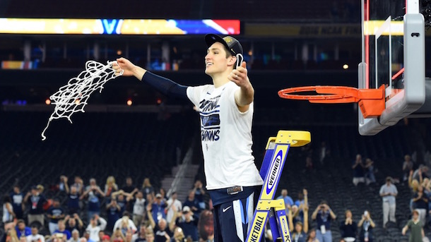 Ryan Arcidiacono cutting down the net