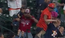 Yet Another Dad Holding a Baby Caught a Foul Ball (Video)