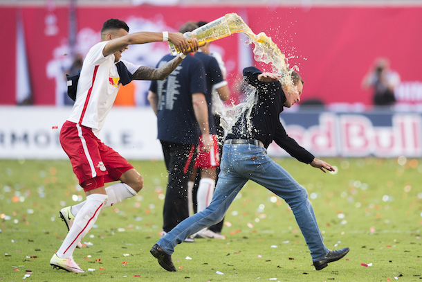 Ralf-Rangnick-german-soccer-coach-tears-hamstring-running-away-from-celebratory-beer-shower