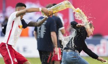 German Soccer Coach Tears Hamstring Trying to Run from Celebratory Beer Shower (Video + Pics)