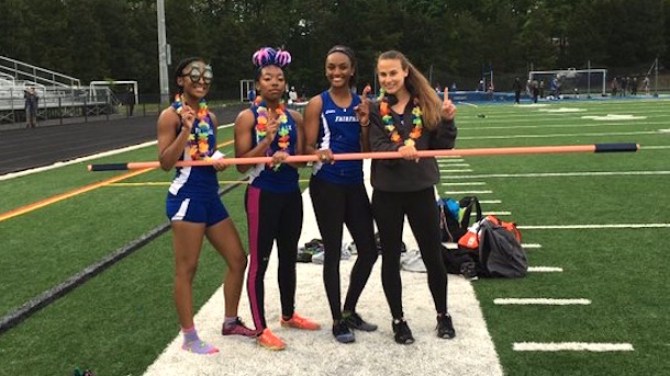 girls high school relay team uses high jump bar as baton wins race