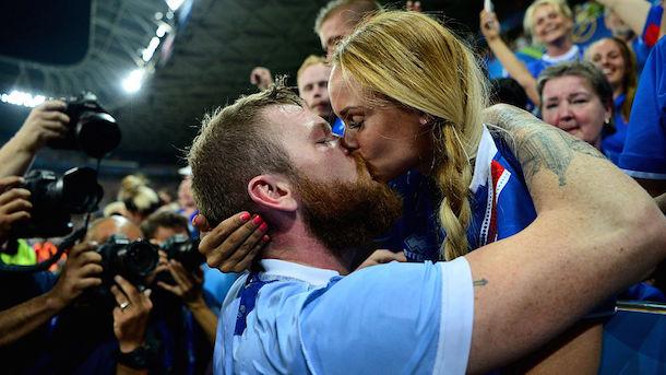 Iceland Captain Aron Gunnarsson kisses girlfriend Kris Jonasdottir England-Iceland
