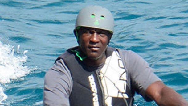 michael jordan wears a helmet while jet skiing