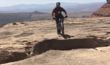 Mountain Biker Narrowly Avoids Death When this Mountaintop Wheelie Goes Wrong (Video)