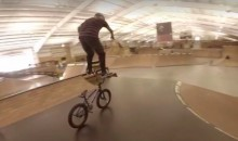 Watch This Insane BMX Rider Cruise Around While Standing on His Handlebars (Video)