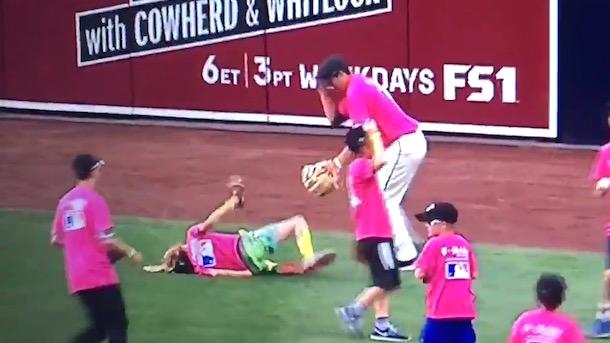 giant kid slams into smaller kid shagging balls at mlb home run derby