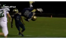 High School Player Does A Backside Flip Over Defender, & Keeps Running (VIDEO)
