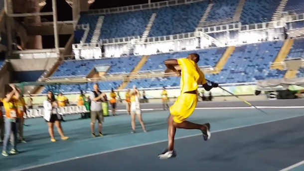 usain bolt throws javelin in olympic stadium after everybody went home