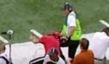 Sideline Worker at UT-Notre Dame Game Takes an Errant Pass to the Head (Video)