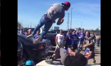 Buffalo Bills Fan Elbow Drops Another Fan Through a Table (Video)