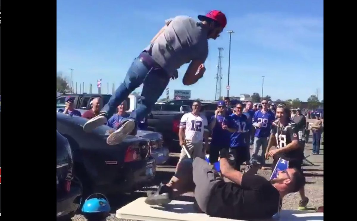 buffalo bills fan elbow drops another fan through a table