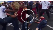 Male Cowboys Fan Pushes & Punches Female Redskins Fans (Video)