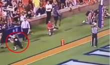 Woman on Sidelines Attempts to Catch Kickoff; Fails Badly & Takes Ball To The Face (Video)