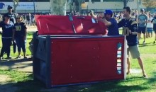 Seahawks Fan Pushes Over Porta-Potty That Was Occupied by a Rams Fan (Video)
