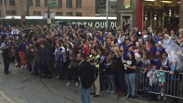 cubs-fans-line-streets-cubs-bus-to-cleveland