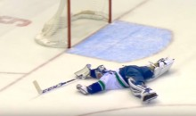 Canucks Goalie Ryan Miller Makes Ridiculous Diving Glove Save to Prevent Empty Netter (Video)