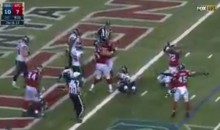 Russell Wilson Trips Over Lineman For a Safety (Video)