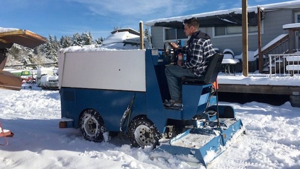 canadian uses zamboni to clear snow