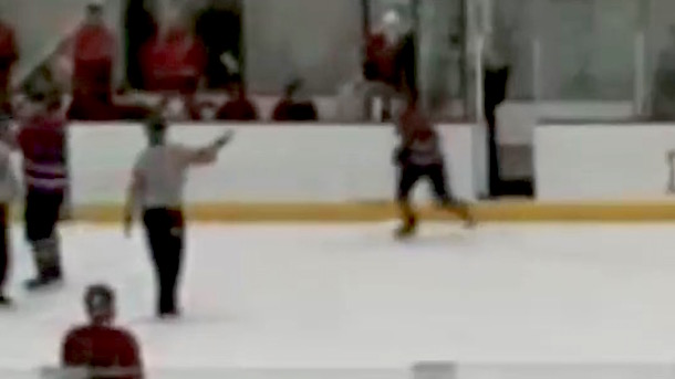 junior college hockey player leaves penalty box and attacks referee