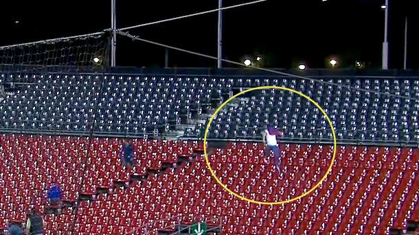baseball fan runs across tops of seats to get foul ball world baseball classic
