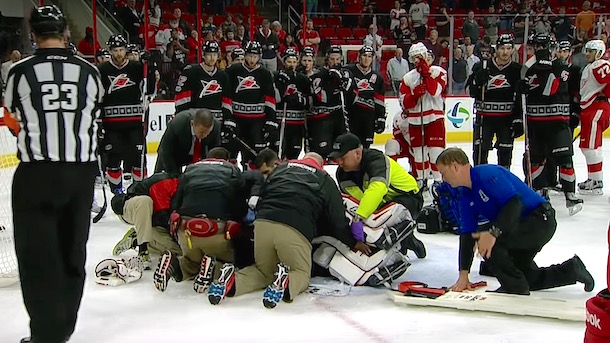 hurricanes goalie eddie lack stretchered off ice