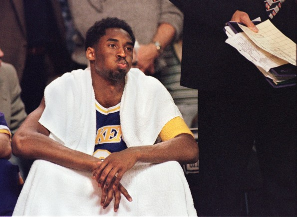 Los Angeles Lakers' Kobe Bryant watches his teamma