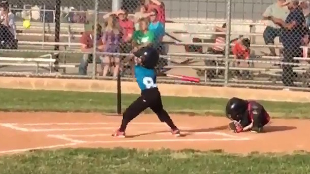 adorable 7-year-old catcher rolls up like armadilla