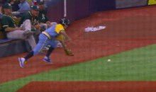 Ballboy Makes an Amazing Foul Ball Snag, All While Casually Chewing on a Toothpick (Video)