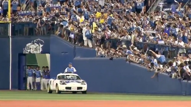japanese closer rides onto field in sports car