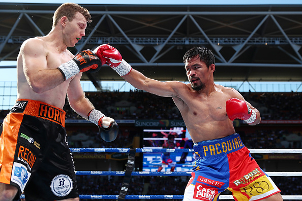 Boxing greats slam Pacquaio for not accepting he lost