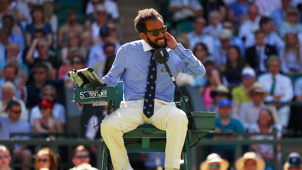 Chair umpire Kader Nouni swats flying ants during a Ladies Singles second round match on Day 3 of Wimbledon 2017. (Image via Getty)