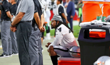 Raiders RB Marshawn Lynch Sits During Playing of The National Anthem