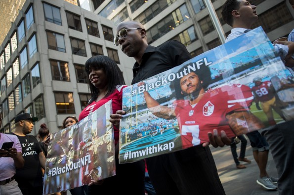 Rally In Support Of NFL Quarterback Colin Kaepernick Outside The League's HQ In New York