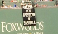 "Sign Reading ""Racism Is As American As Baseball"" Appears on Green Monster at Fenway Park (PICS)"
