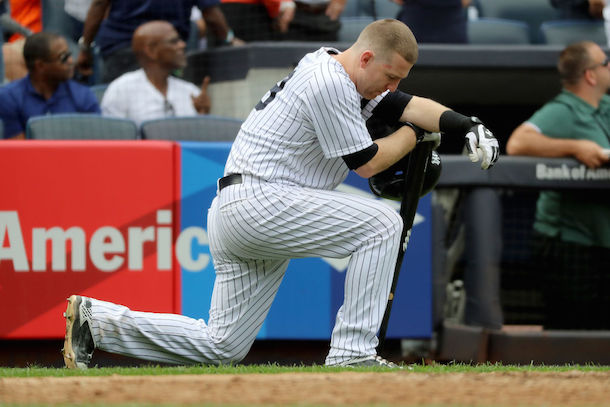 Image via Getty / Todd Frazier #29 of the New York Yankees reacts after a child was hit by a foul ball off his bat in the fifth inning against the Minnesota Twins on September 20, 2017 at Yankee Stadium