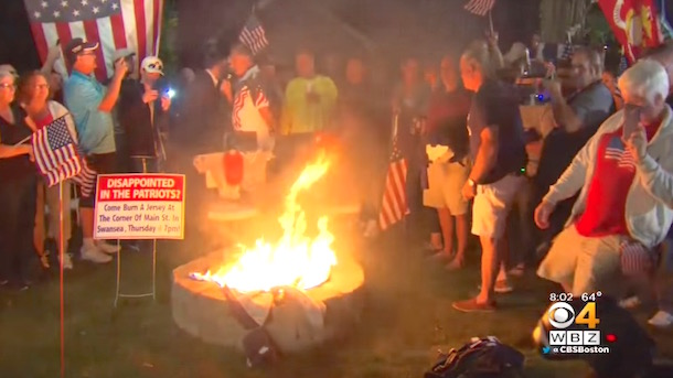 angry patriots fan throw patriots gear-burning party
