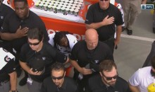 Raiders Staffers Attempt To Cover Marshawn Lynch As He Sits During National Anthem