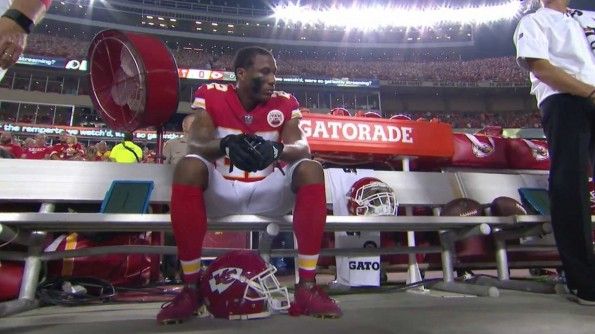 marcus_peters_sits_during_national_anthem