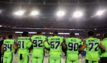 Seahawks' Michael Bennett Stands For Anthem To Support Military Before Veterans Day