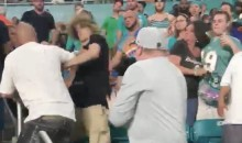 Raiders Fan Gets Jumped By Dolphins Fans During SNF; GF Has To Jump In To Stop It (VIDEO)