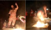 Chiefs Fan Channels His Inner 'Bills Mafia' & Drops A Macho Man Elbow on Flaming Table (VIDEO)